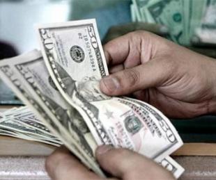 foto: Tras el lunes negro, el dólar sube a $61 en el Banco Nación