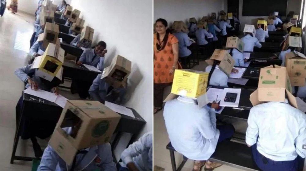 foto: Para que no se copien, alumnos usan cajas de cartón en la cabeza