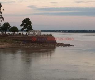 foto: Rescataron a una mujer y a sus dos hijos que se ahogaban en el río